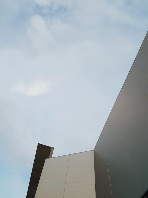 Modern building located under blue sky