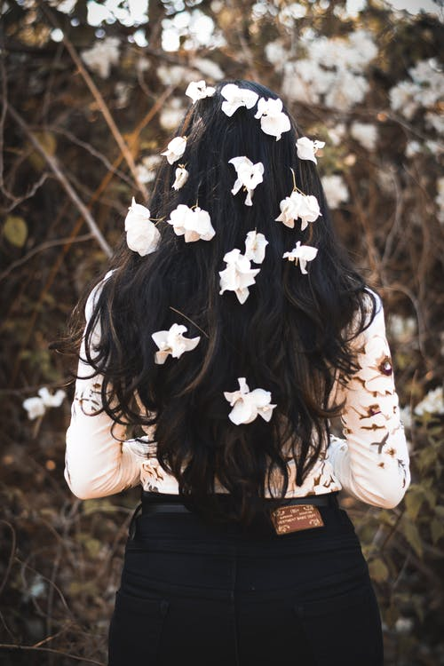 Photo of Woman With Flowers On Her Hair