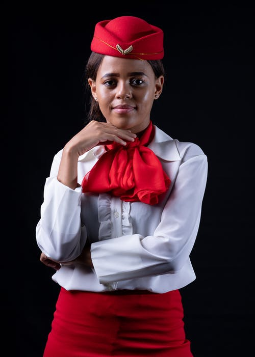Woman In Red And White Uniform