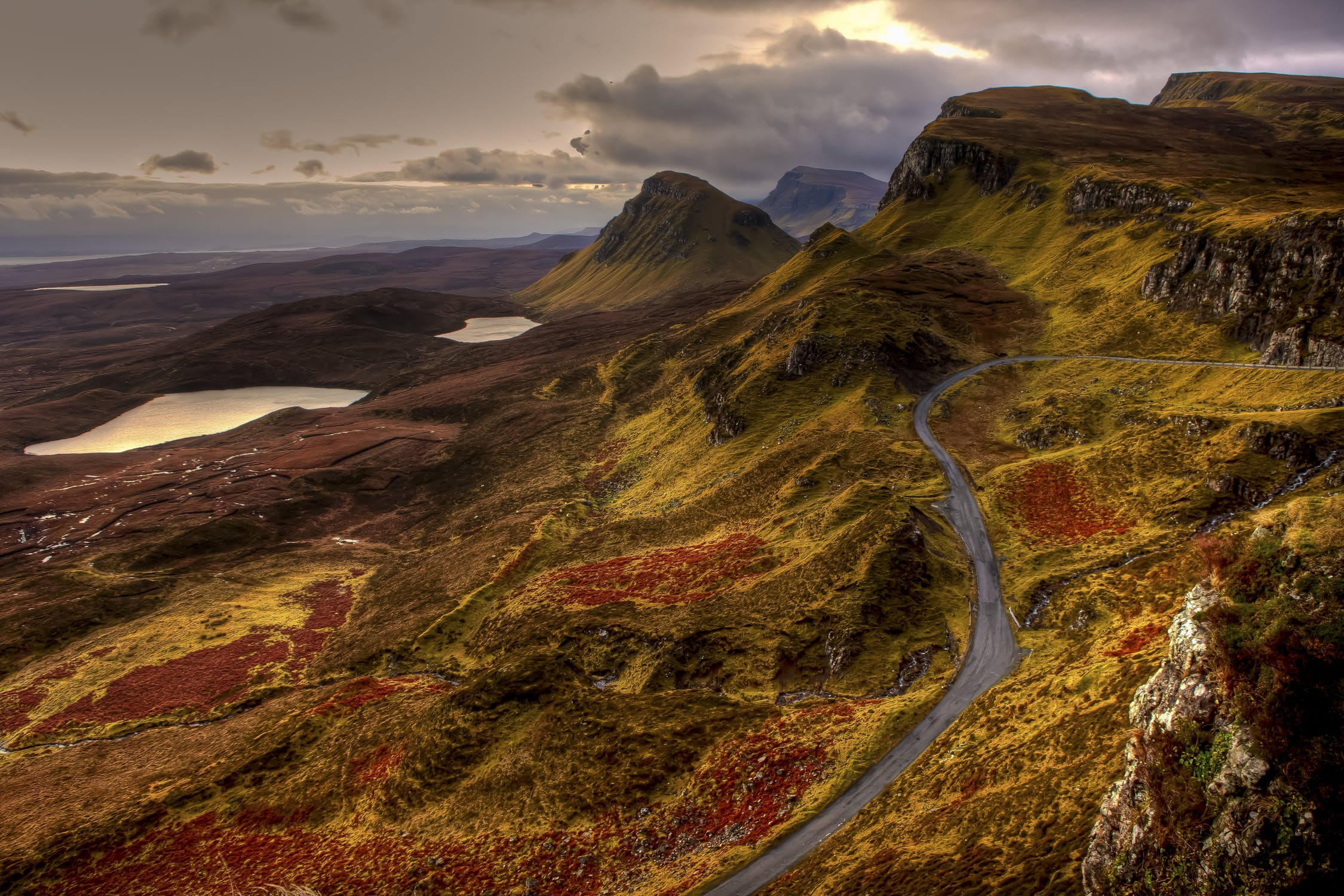 A road winding through a picturesque Scottish landscape. One way to enjoy a Scottish Staycation.