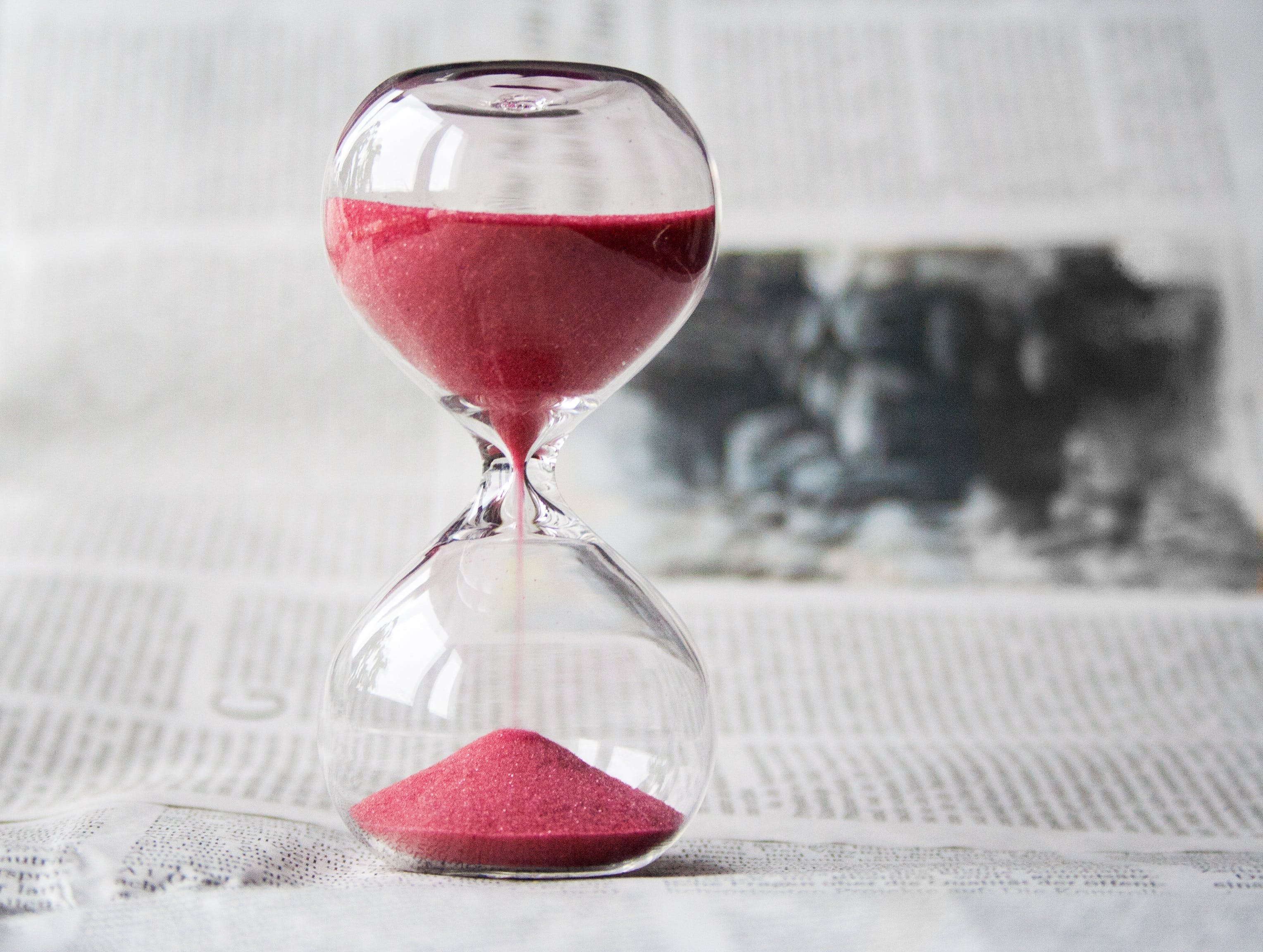 An hourglass - because you need to consider time when deciding between renting vs buying office space in NJ.