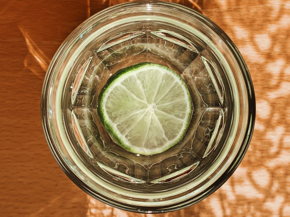 Clear Drinking Glass With Sliced Lemon