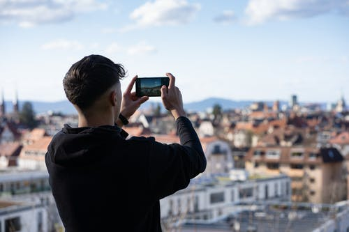 Free stock photo of black hoodie, city, city view