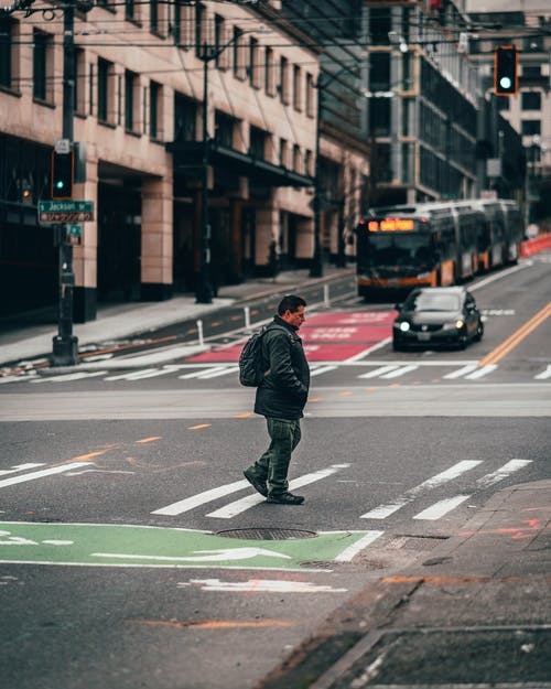 Man Walking On Pedestrian Lane