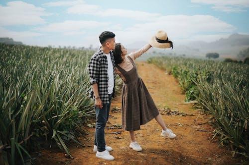 Man And Woman At A Farmland