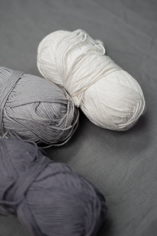 White Yarn on Gray Textile