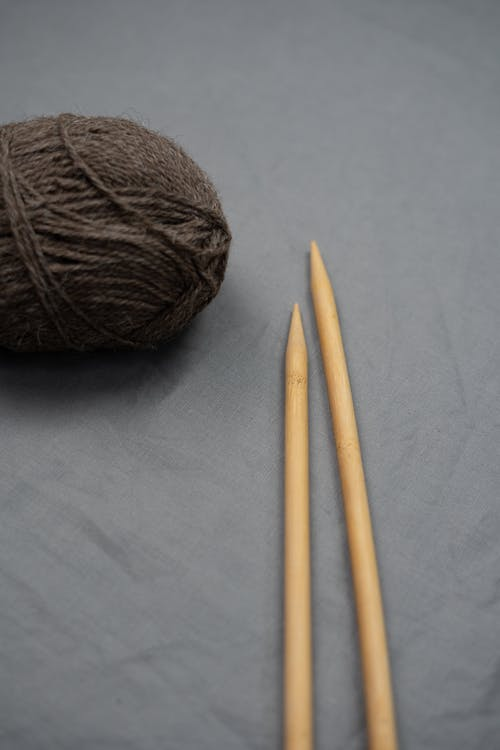 Brown Yarn on White Textile