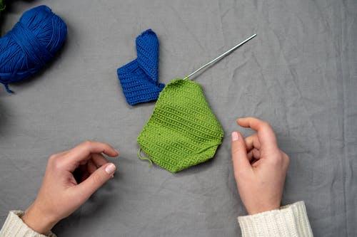 Green Knit Textile on Gray Textile
