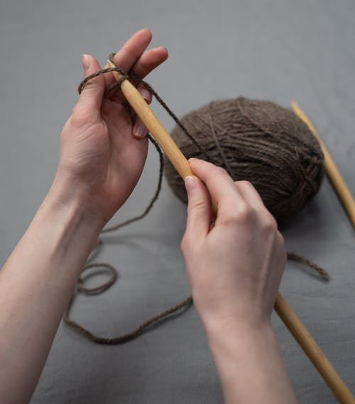 Person Holding Brown Yarn Roll