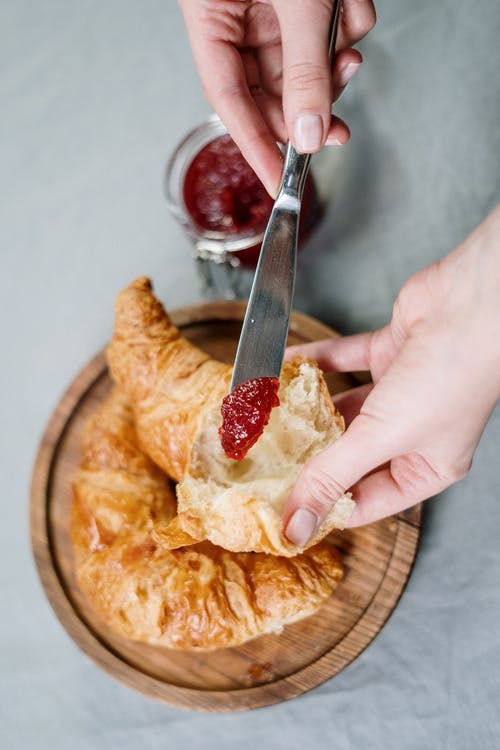 Person Holding A Knife With Jam