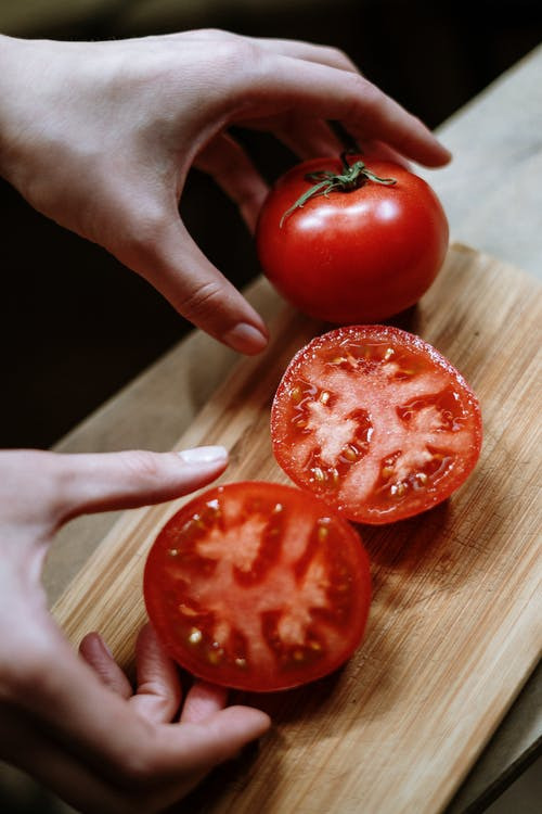 Person Holding Red Tomato Fruit