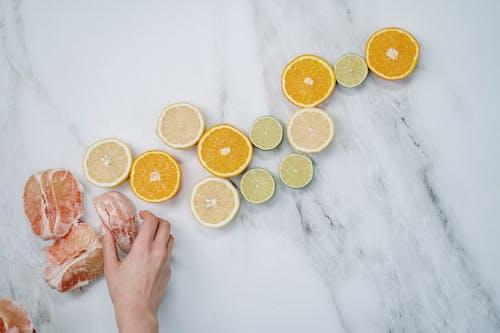 Sliced Orange Fruits on White Table