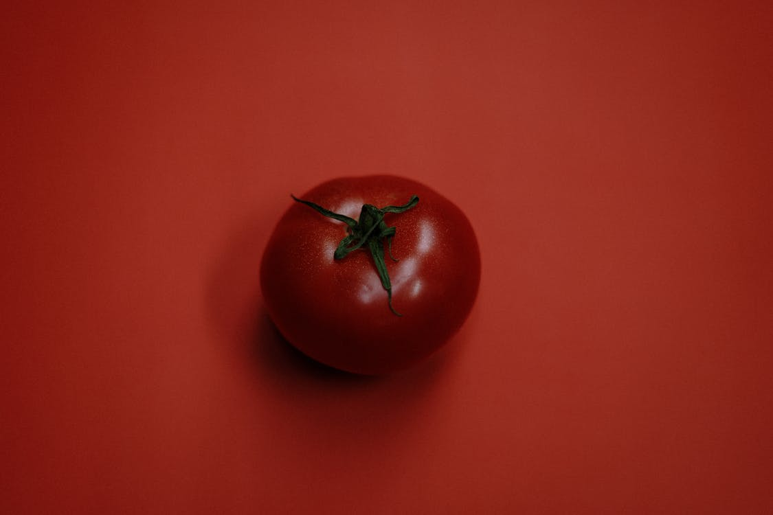 Red Tomato On Red Surface