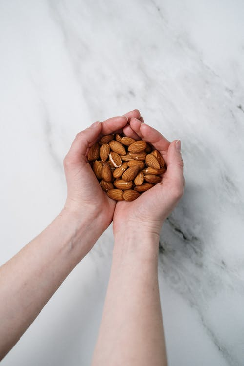 Person Holding Almonds
