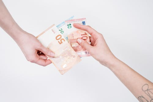 Person Holding 10 Euro Bill