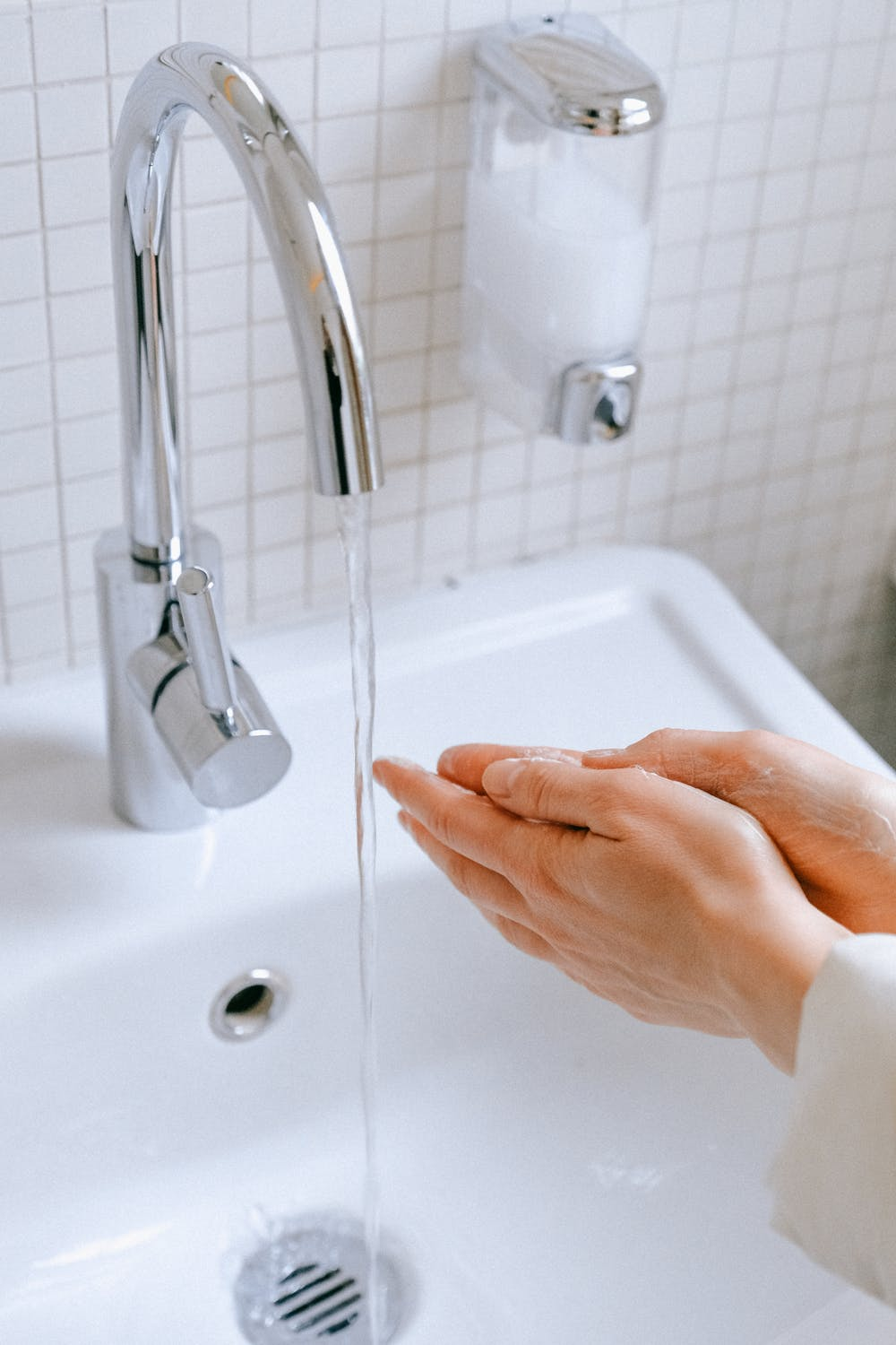 A person washing their hands with soap