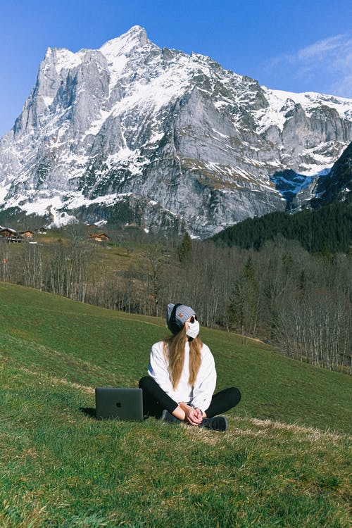 Woman Wearing Face Mask on Mountain