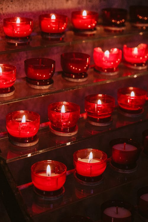 Candles On Red Glass