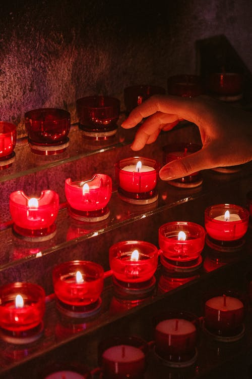 Red Candles on Clear Glass Containers