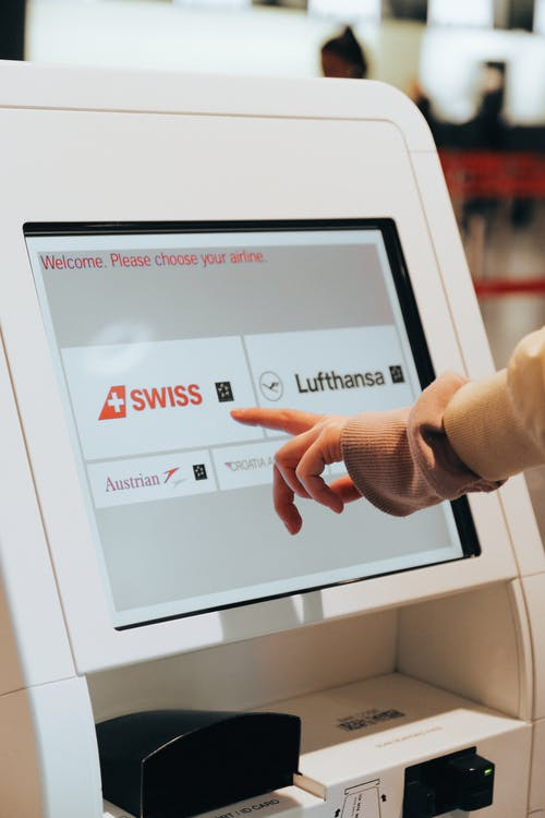 Person Using Self Check In Kiosk