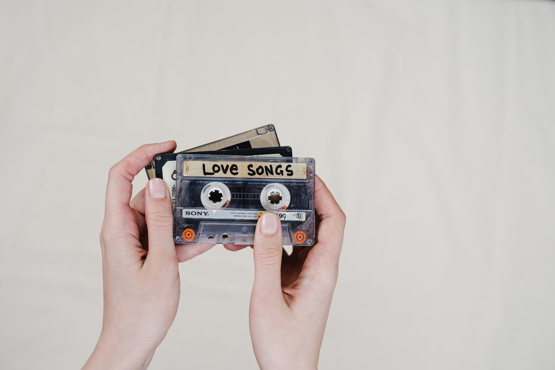 Person Holding Cassette Tapes