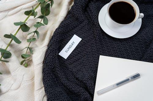 White Ceramic Mug on Black Textile