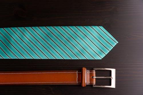 Striped Necktie Beside Leather Belt