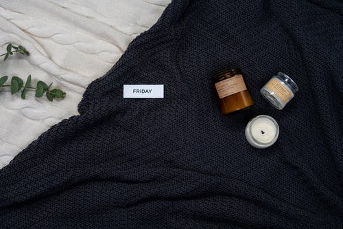 Black Textile With Orange and White Medicine Bottle