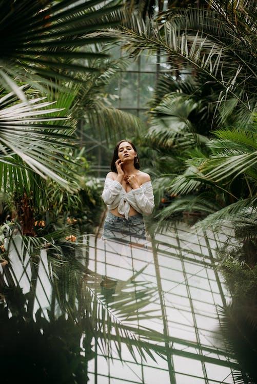 Woman In White Top Near Plants
