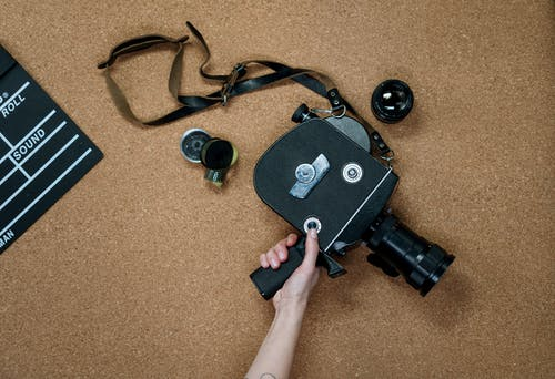 Black and Gray Camera on Brown Carpet
