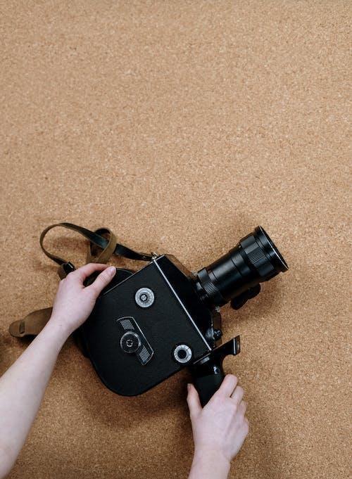 Black Dslr Camera on Brown Carpet