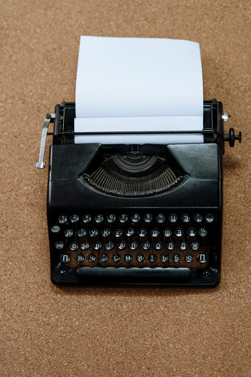 Black and White Typewriter on Brown Carpet