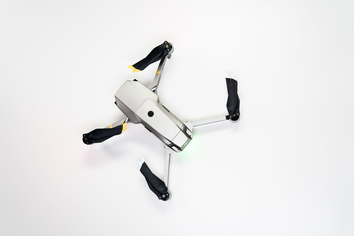 White and Black Drone on White Surface
