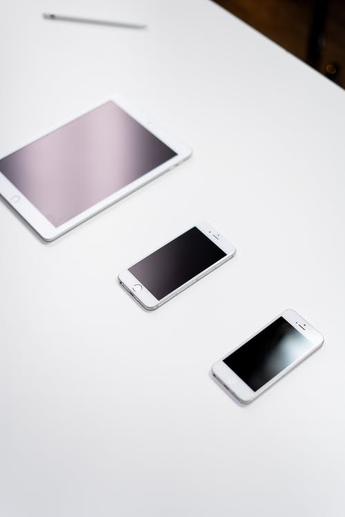 White Samsung Galaxy Smartphone Beside White Smartphone
