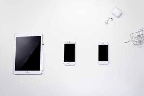 White Iphone 5 on White Table