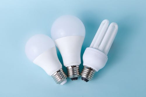 White Light Bulbs On A Blue Surface