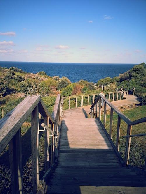 Безкоштовне стокове фото на тему «дерев'яний міст, міст, море»