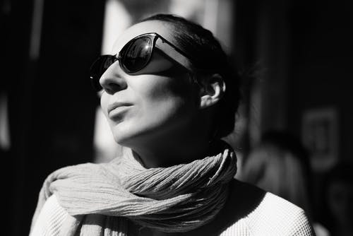 Grayscale Photo Of Woman Wearing A Scarf And Sunglasses