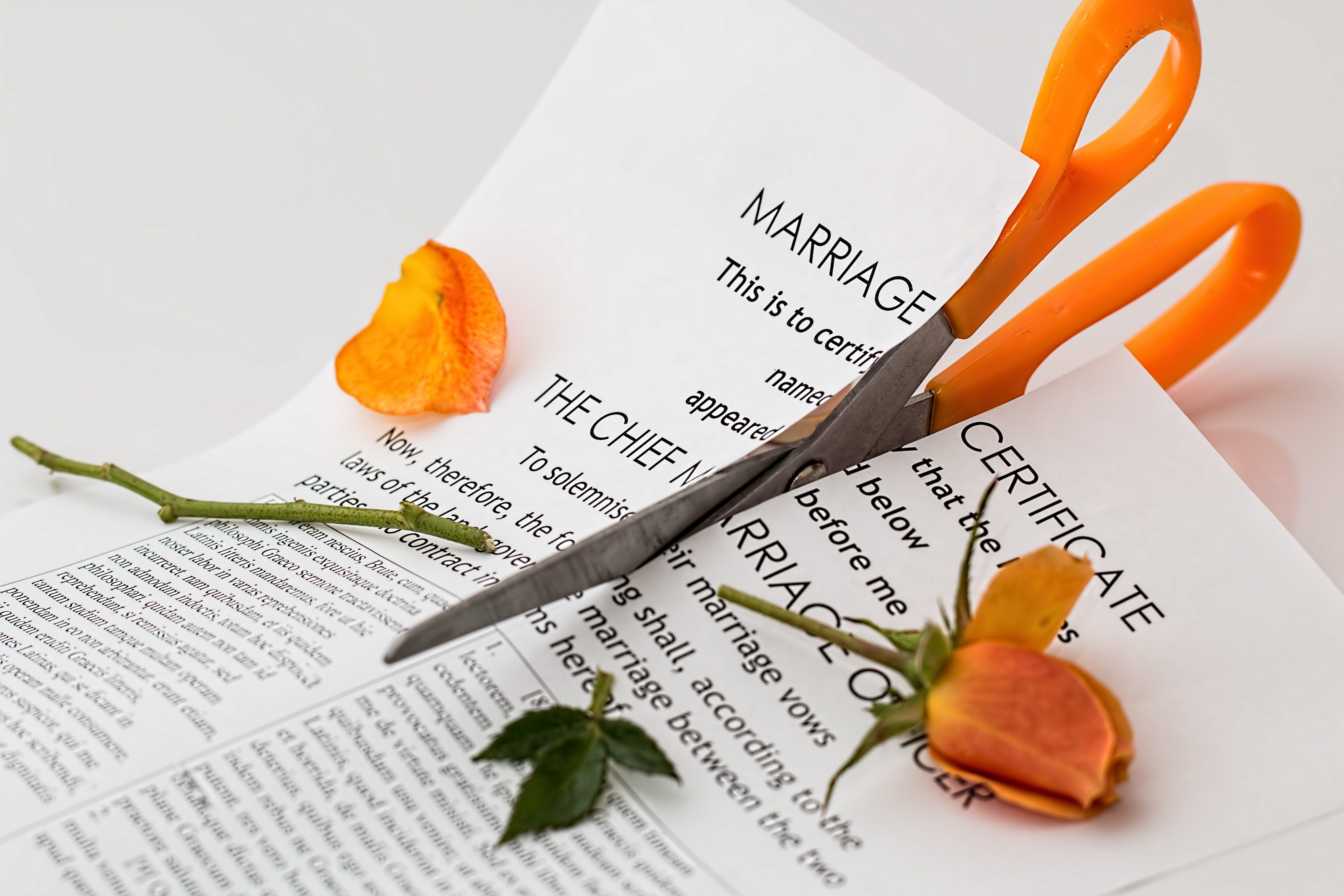 Printer Paper Cut With Orange Scissor