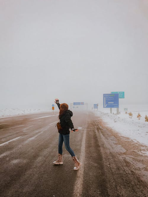 Woman Standing On Side Of The Road