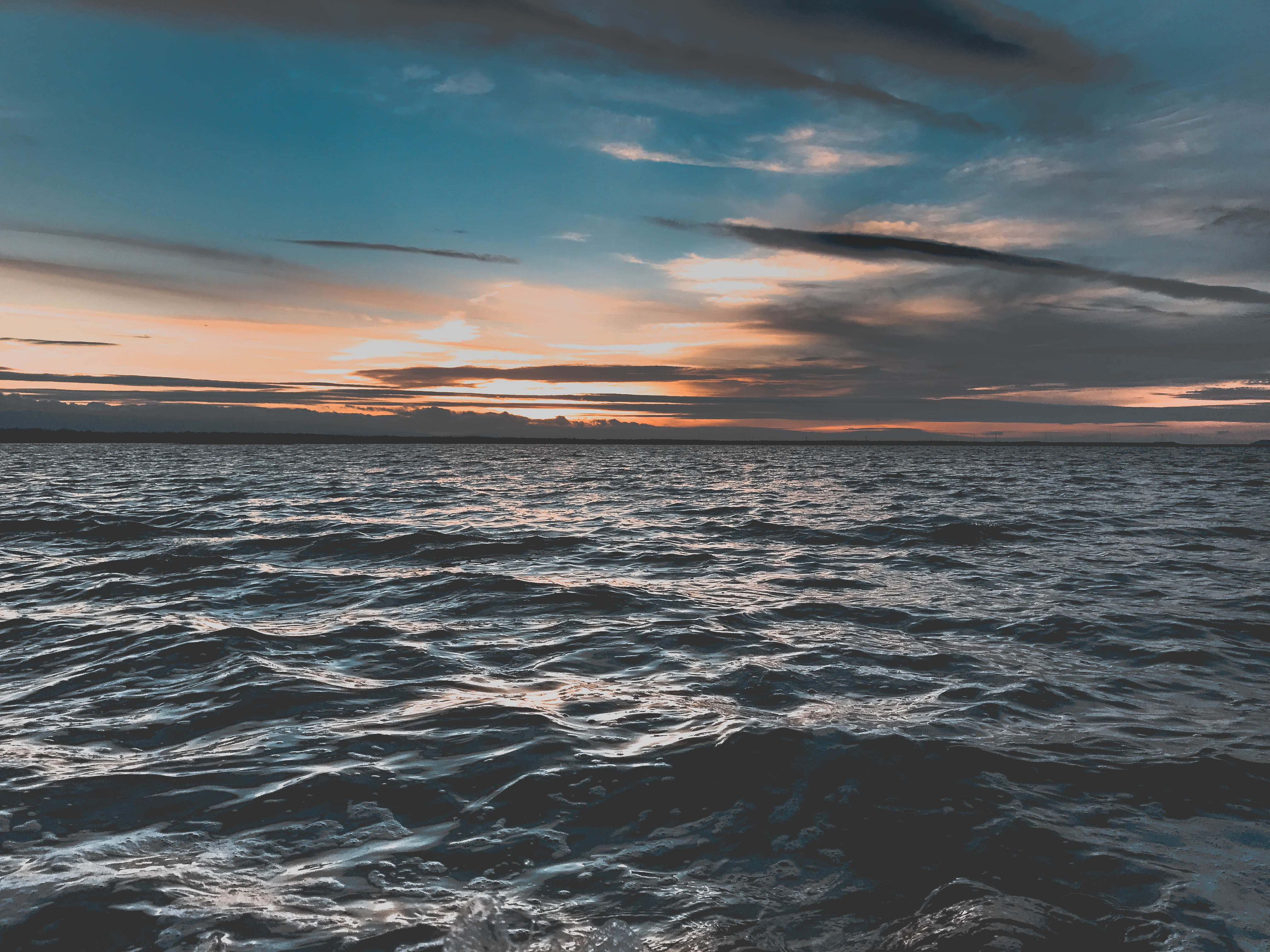 Body of Water Under Gray Clouds