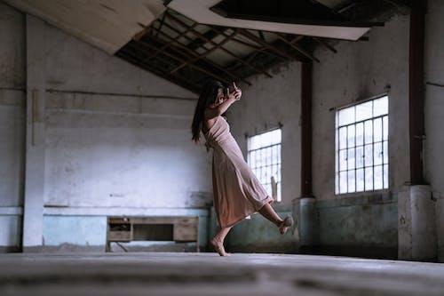 Woman In Pink Dress Dancing