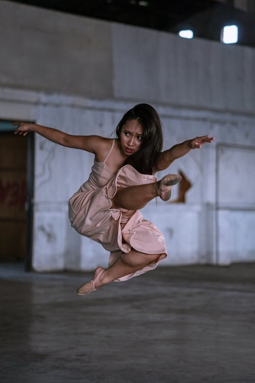 Woman In Pink Dress Jumping