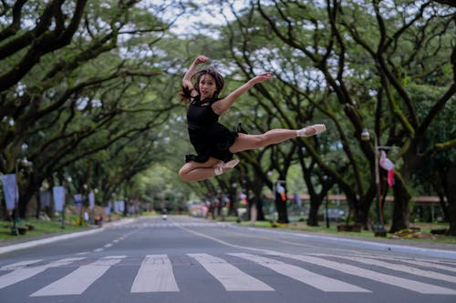 Woman Doing Ballet In The Middle Of The Road