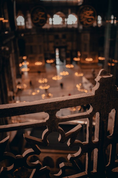From above through ornamental cozy railing interior of public spacious medieval building