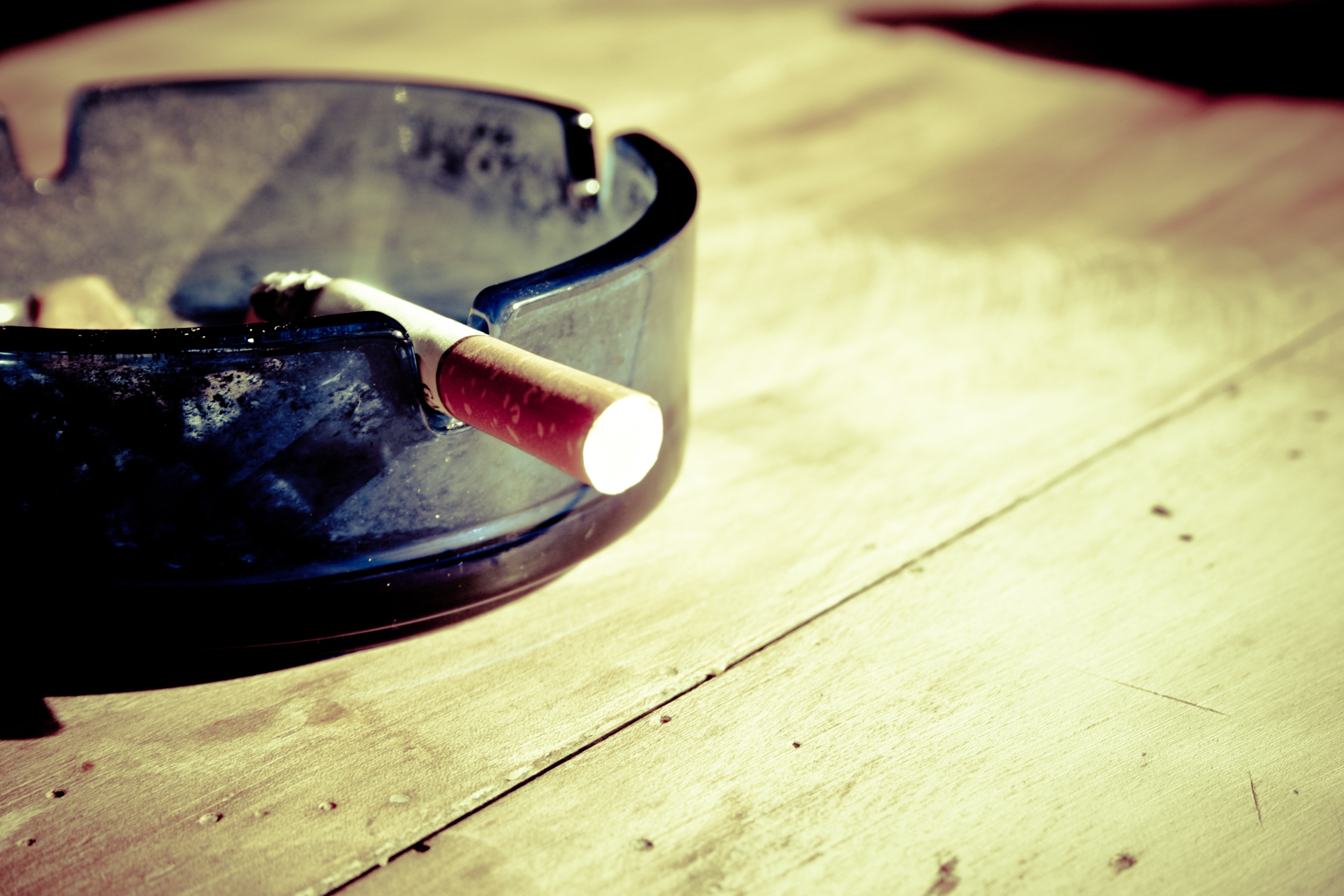 Lit Cigarette in Ashtray