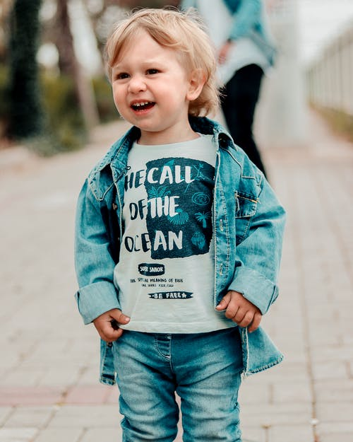Kid In Denim Jacket Standing