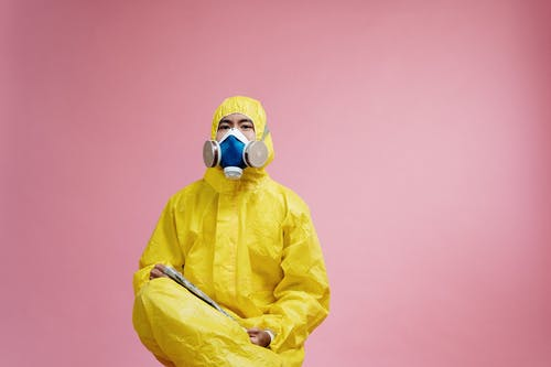 Person Wearing Yellow Protective Suit