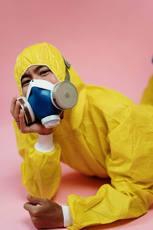 Person In Yellow Protective Suit And Mask