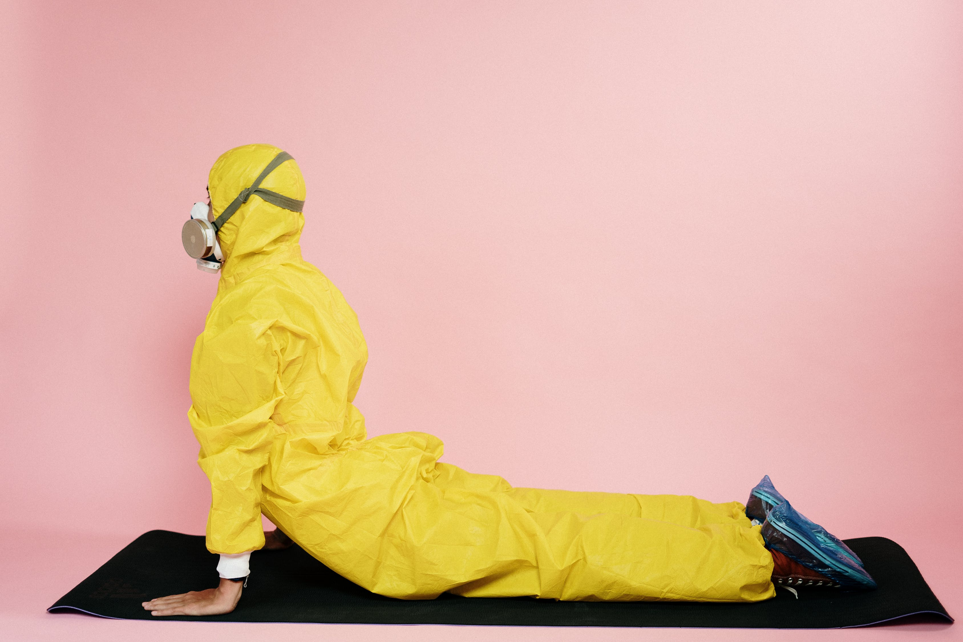 Man In Yellow Protective Suit Stretching